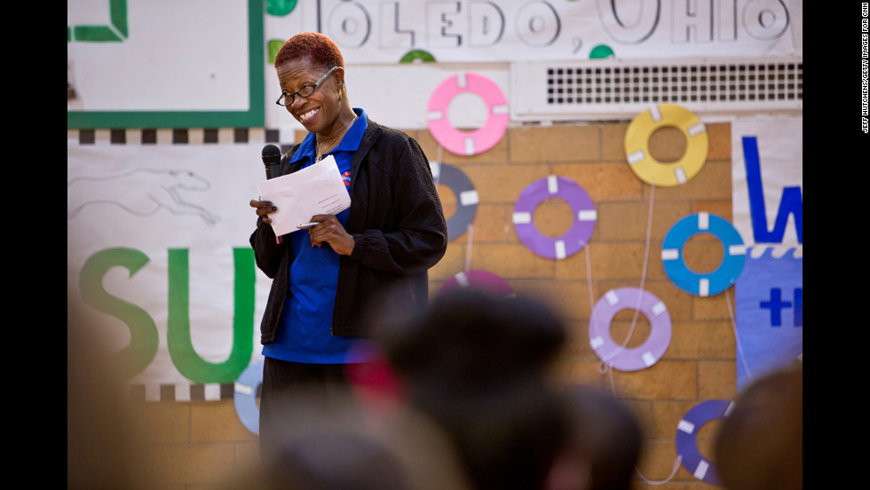 Butts talks about water safety during an assembly at the Gesu School in Toledo, Ohio. One of her goals is to raise awareness about drowning prevention, especially in communities where statistics indicate drownings are more likely to happen.