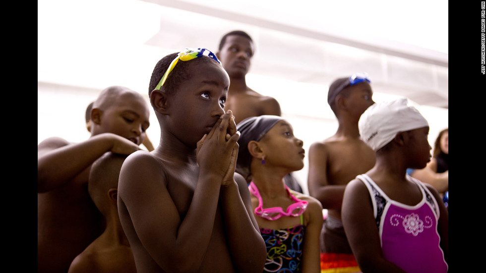 Children prepare for swimming lessons at St. Francis de Sales High School in Toledo.