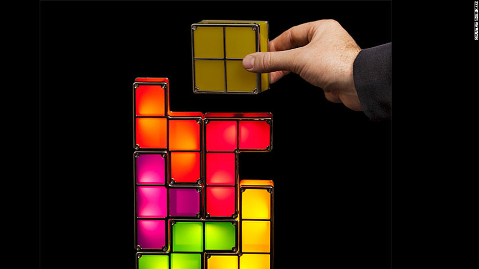 "Tetris lovers of all ages will dig this stackable LED desk lamp, and its seven pieces -- like the video game -- can be stacked in nearly endless combinations. The light flicks on when the pieces are stacked together and stays off when they're  dissembled. The whole thing plugs into a wall outlet and is available for $39.99 from <a href=""http://www.thinkgeek.com/product/f034/#tabs"">ThinkGeek</a>."