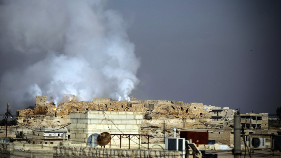 Smoke and fire rise from the Roman citadel of Kalat al-Numan after it was bombed by a Syrian government jet on Tuesday, November 20, in Maaret al-Numan, Syria. The Roman-era town of 150,000 is now virtually deserted due to the heavy shelling and aerial bombardments.