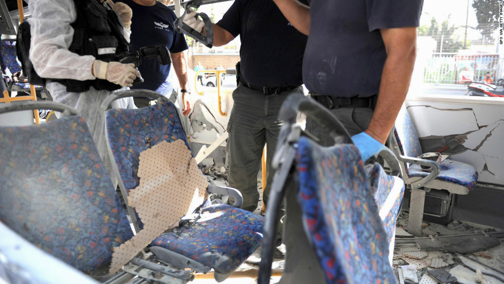 Emergency services attend the scene after a bus explosion in central Tel Aviv.