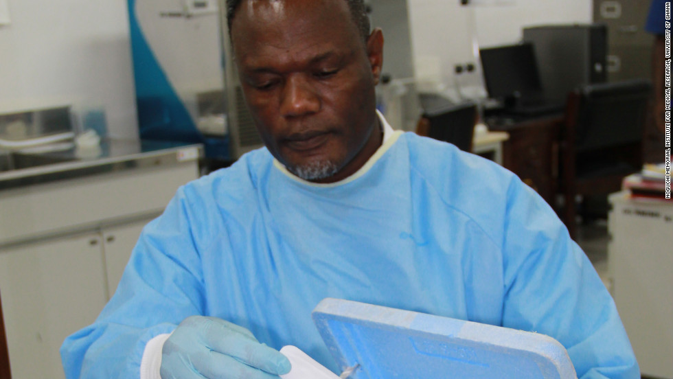 Dr. Anthony Ablordey handles a point-of-care test sample in a lab at the University of Ghana. The test aims to provide rapid and accurate detection of the Buruli ulcer disease in poor places.