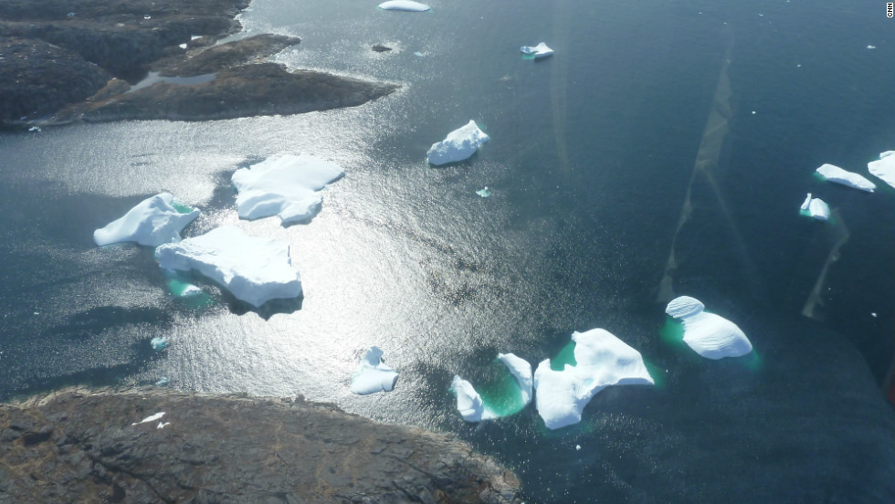 From the air it is easy to see that most of the icebergs' mass is below the water surface making it dangerous for ships to pass them.