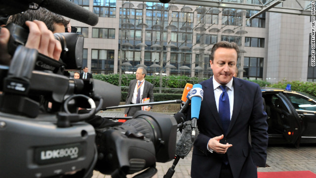 British Prime Minister David Cameron arrives to Brussels for a two-day EU leaders summit on November 22.