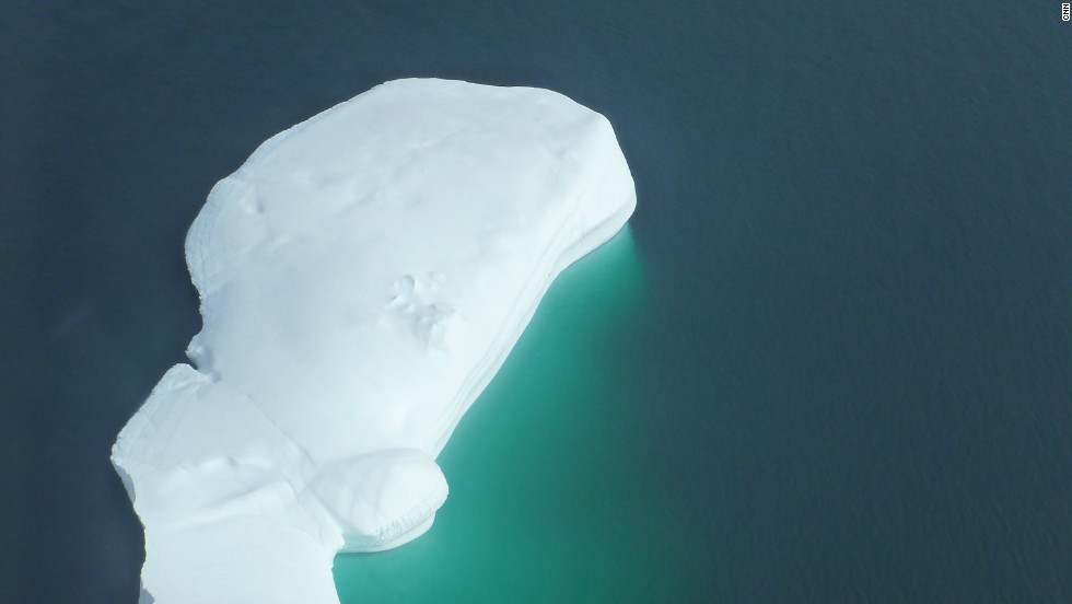 SIngle iceberg under the survey helicopter.