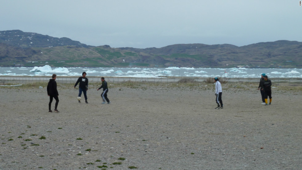 Greenlanders play soccer in front of a field of icebergs. It seems this place was much more hospitable 1,000 years ago.
