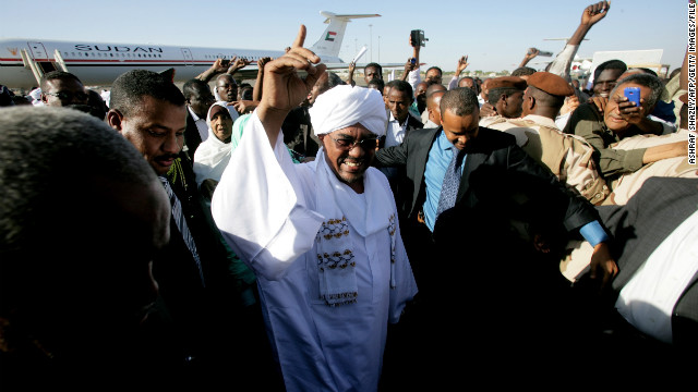 (File photo) Sudanese President Omar al-Bashir gestures as he arrives at Khartoum airport on November 14, 2012.