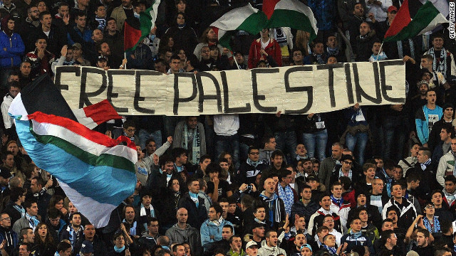 "A section of Lazio fans unfold a ""Free Palestine"" banner during their 0-0 Europa League home draw with Tottenham."