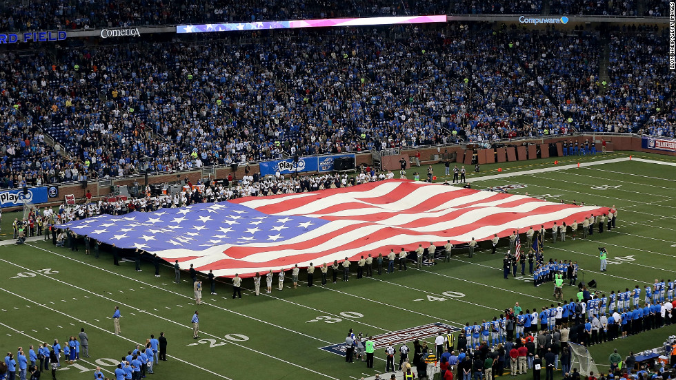 "An American flag is unfurled at Ford Field before the Texans-Lions game on Thursday in Detroit. <a href=""http://www.cnn.com/2012/11/16/worldsport/gallery/nfl-week-11/index.html"">Look back at the best photos from Week 11 of the NFL.</a>"