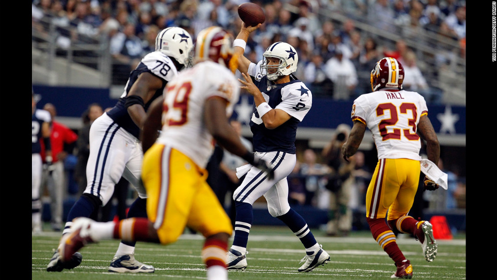 Cowboys quarterback Tony Romo fires a pass under pressure from the Redskins.