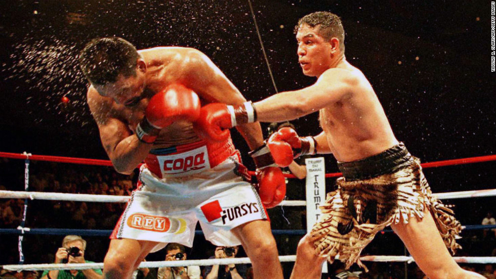 Camacho lands a punch to his opponent, Roberto Duran, during their IBC middleweight fight in Atlantic City, New Jersey, in 1996. Camacho won in a 12-round decision.