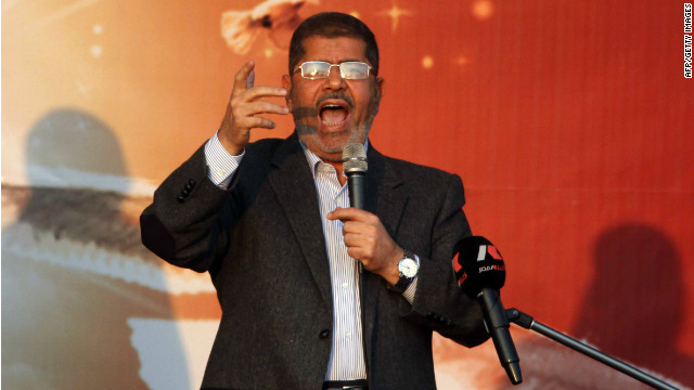 Egypt's Islamist President Mohamed Morsy waves to his supporters in November.