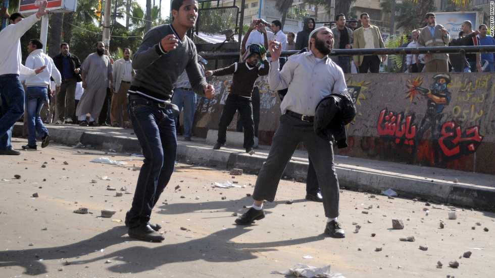 Egyptian supporters and opponents of Morsy clash in the coastal city of Alexandria on Friday.