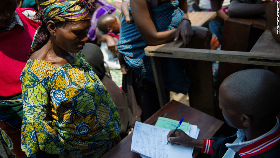 A displaced Congolese woman registers at a camp for displaced persons at Mugunga, 8km from the centre of Goma on November 22, 2012.
