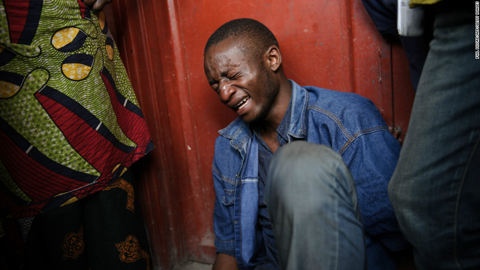 Lokuli Loleko Prince finds the body of his father in Goma on November 21, 2012. Lokuli's father, a government military doctor, was killed in fighting between the government army and M23 rebels as they took the provincial capital.