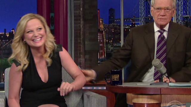 Letterman plants kiss on Amy Poehler