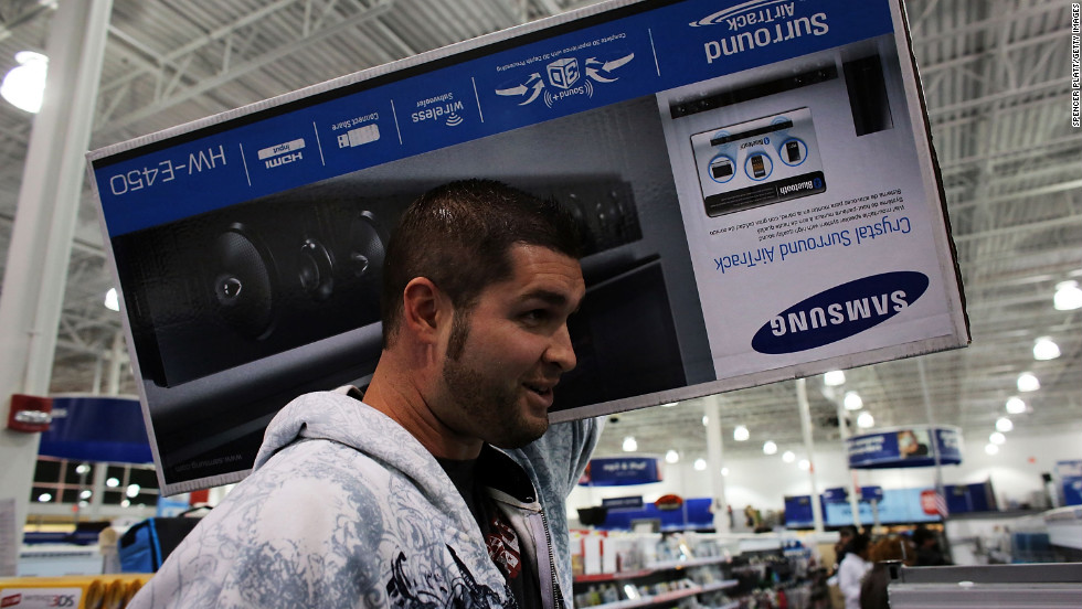 A shopper scores a Samsung sound bar at a Best Buy store in Naples, Florida.