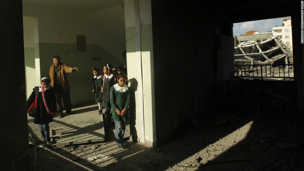 Palestinians school girls walks along a corridor of their school in Gaza City on Saturday.