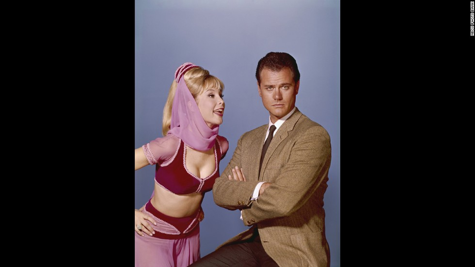 Barbara Eden and Hagman pose for a photo as their 'I Dream of Jeannie' characters.
