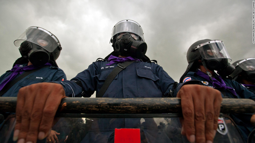 Thai riot police officers stand guard on Saturday.