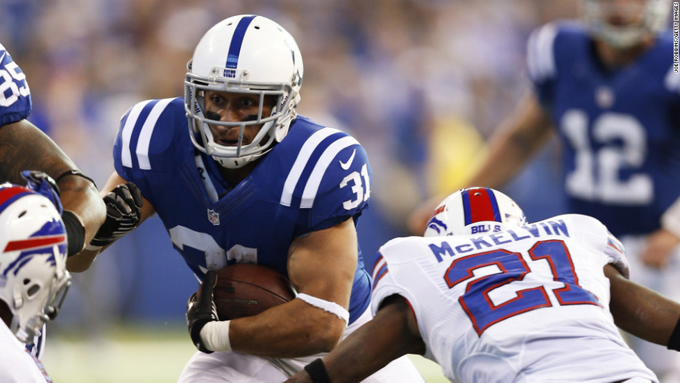 Donald Brown of the Colts runs with the ball against the Bills on Sunday.