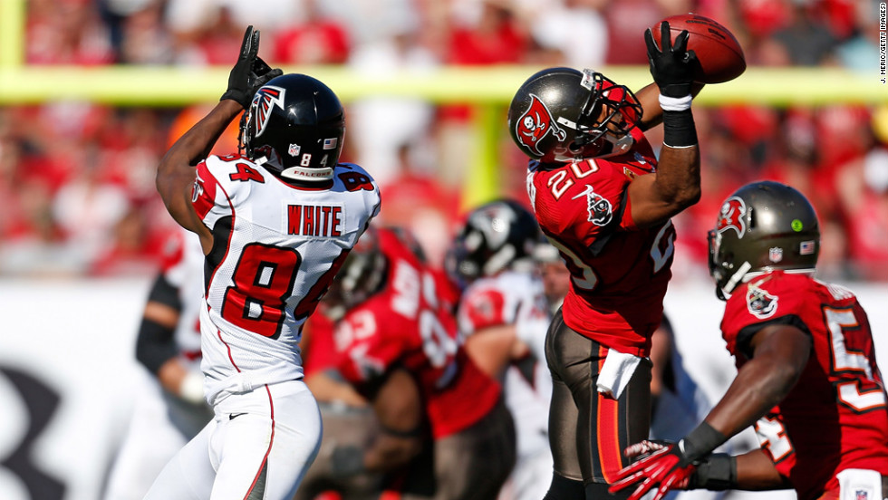 Safety Ronde Barber of the Tampa Bay Buccaneers intercepts a pass intended for receiver Roddy White of the Atlanta Falcons at Raymond James Stadium on Sunday in Tampa, Florida.