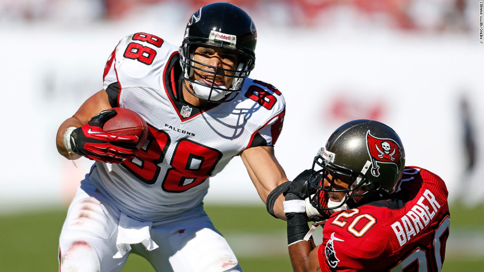 Tight end Tony Gonzalez of the Falcons straight arms safety Ronde Barber of the Buccaneers on Sunday.