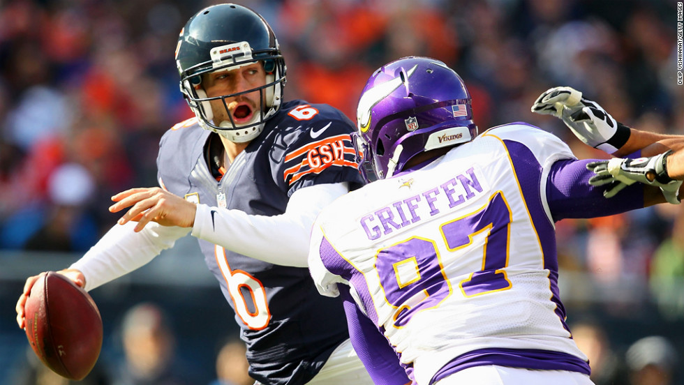 Jay Cutler of the Bears looks to avoid being sacked by Everson Griffen of the Vikings on Sunday.