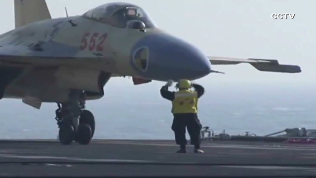 Watch Chinese fighter jet land on aircraft carrier