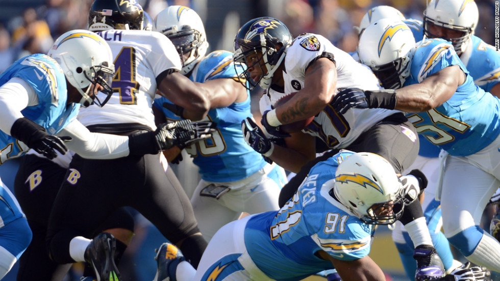 Ray Rice of the Ravens is tackled by Takeo Spikes and Kendall Reyes of the Chargers for a stop on third down on Sunday.