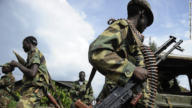 M23 rebel soldiers stand guard at the former Congolese army headquarters in Goma, on Friday, after it was abandoned.