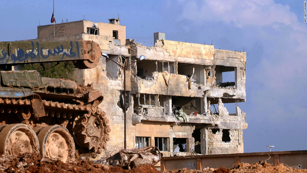The scars of war -- damage is readily visible at a government-controlled building in al-Layramun district of Aleppo on Monday, November 26.