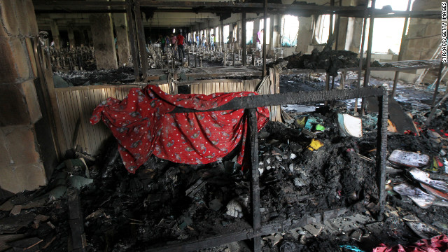 This file photo shows the aftermath of the blaze that tore through the nine-story Tazreen Fashion plant in Bangladesh last year.