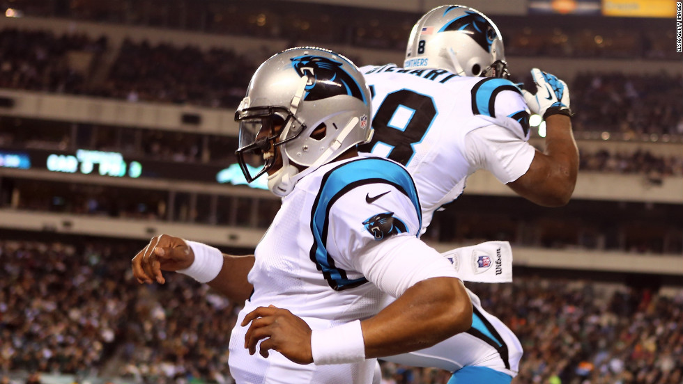 Panthers quarterback Cam Newton, left, celebrates a first quarter touchown with teammate Jonathan Stewart.