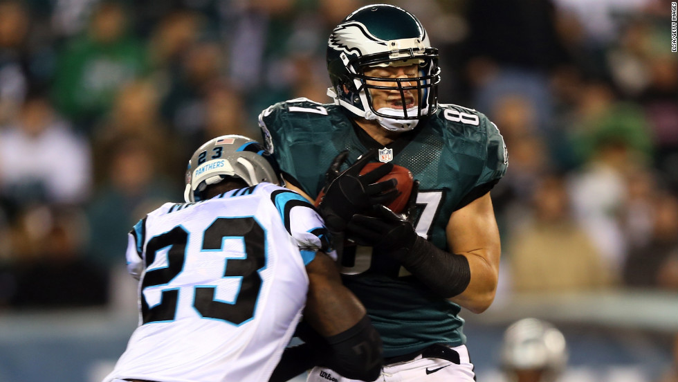 Brent Celek of the Philadelphia Eagles catches a pass as Sherrod Martin of the Carolina Panthers makes the tackle.