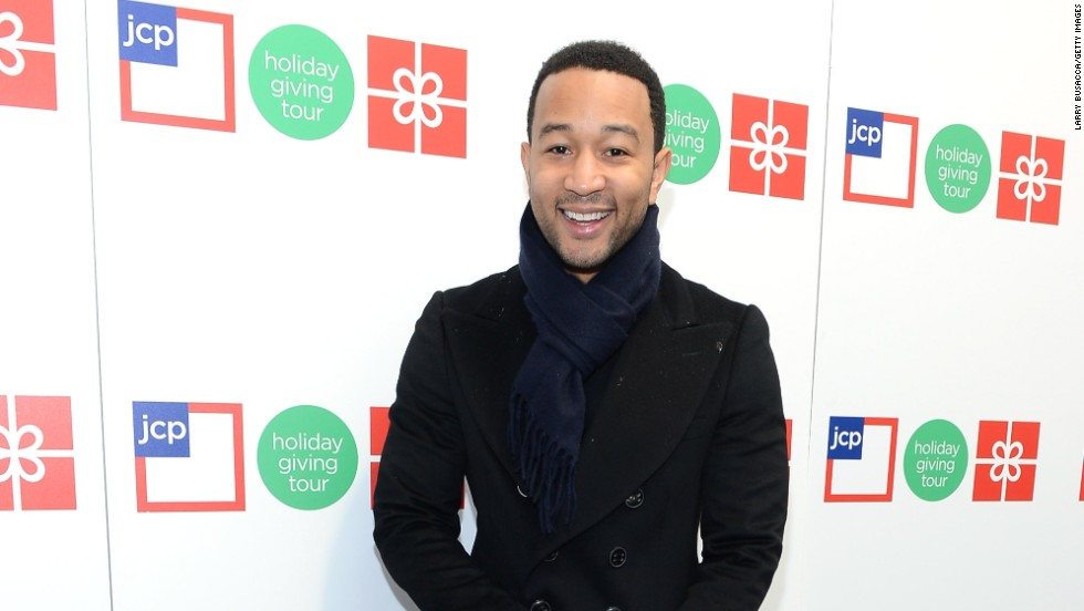 John Legend arrives at jcpenney's Holiday Giving Tour Kick Off on November 27 with pooches Puddy and Pippa in tow.