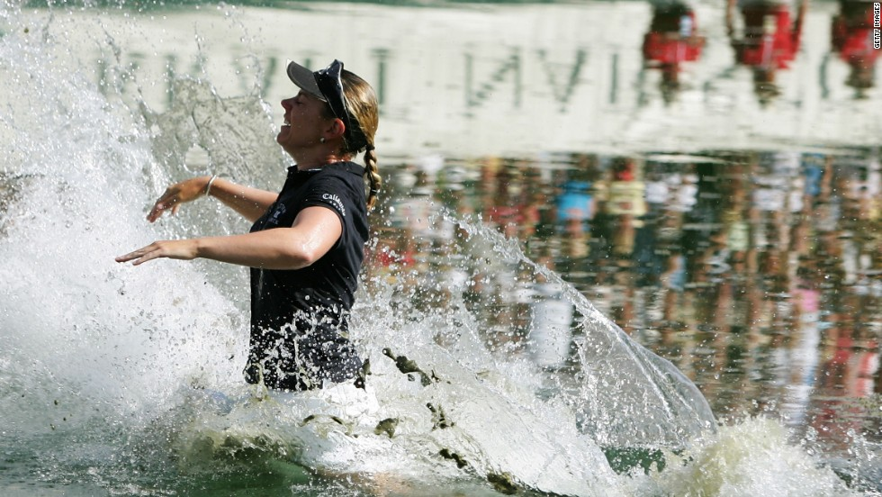 Sorenstam celebrates one of her 10 major titles by taking the traditional winner's leap into the lake after claiming the 2005 Kraft Nabisco Championship.