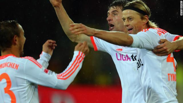 Anatoliy Tymoshchuk celebrates his goal in Bayern Munich's victory at Freiburg with teammates Thomas Mueller and  Rafinha.