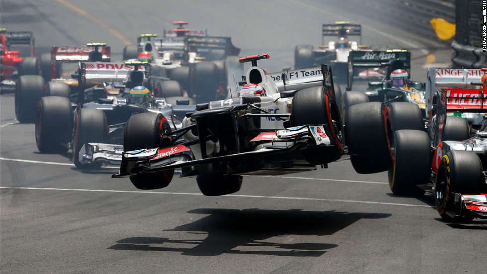 The car driven by Kamui Kobayashi of Japan flies through the air after crashing during the start of the Monaco Formula One Grand Prix at the Circuit de Monaco on May 27 in Monte Carlo, Monaco.