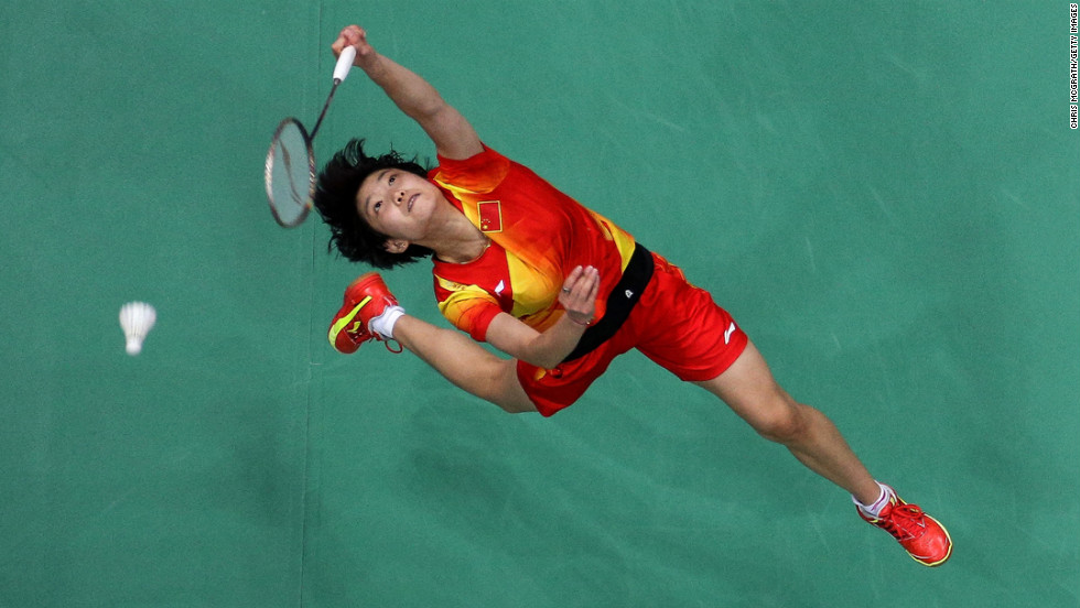 Xin Wang of China reaches for a shot hit by Xuerui Li of China in the women's singles badminton semi-final on Day 7 of the London 2012 Olympic Games on August 3.
