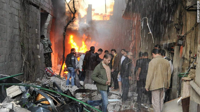 Suicide bombings devastate town near Damascus