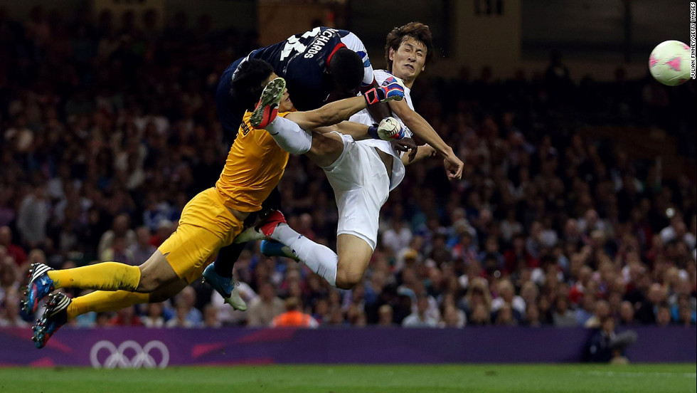 Great Britain's Micah Richards, top left, goes for the ball against South Korea's Jung Sung-ryong and Ji Dong-won in the men's football quarterfinal match on Day 8 of the London 2012 Olympic Games on August 4 in Cardiff, Wales.