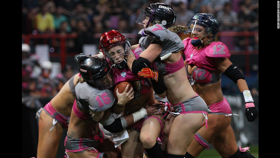 Nikki Johnson of the Western Conference is tackled during first game of the Lingerie Football League All-Star Tour on June 2 in Brisbane, Australia.