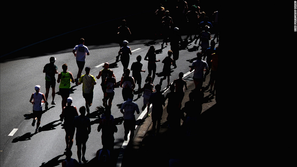 Competitors run under the Sydney Harbour Bridge during the Sydney Running Festival on September 16.
