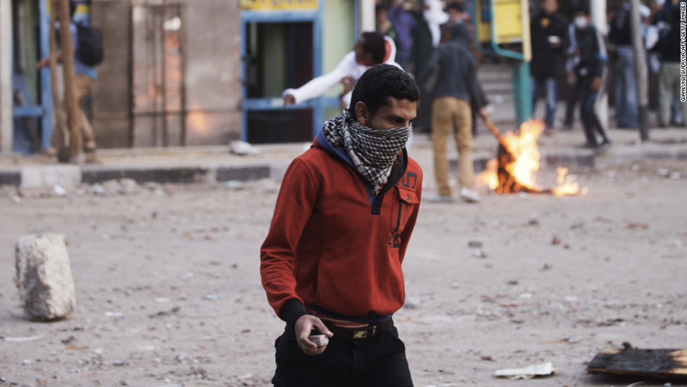 A protester carries a rock during clashes with police on Wednesday.