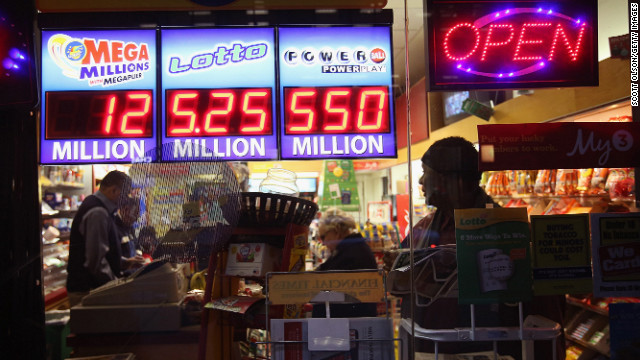 People buy tickets on November 28 for the record Powerball jackpot, which swelled to $587.6 million.