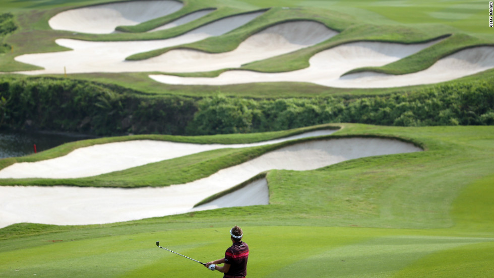 This year the Mission Hills group hosted a World Golf Championship tournament, the HSBC Champions, on a bunker-laden course at its Shenzhen complex designed by former Ryder Cup captain Jose Maria Olazabal. Ian Poulter is seen here on his way to winning the title.