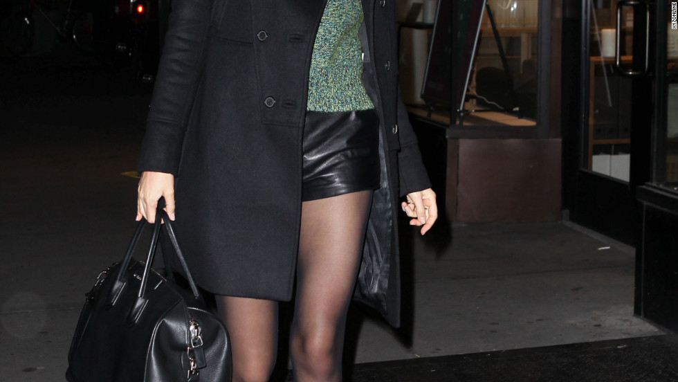 Miranda Kerr heads out wearing leather shorts.