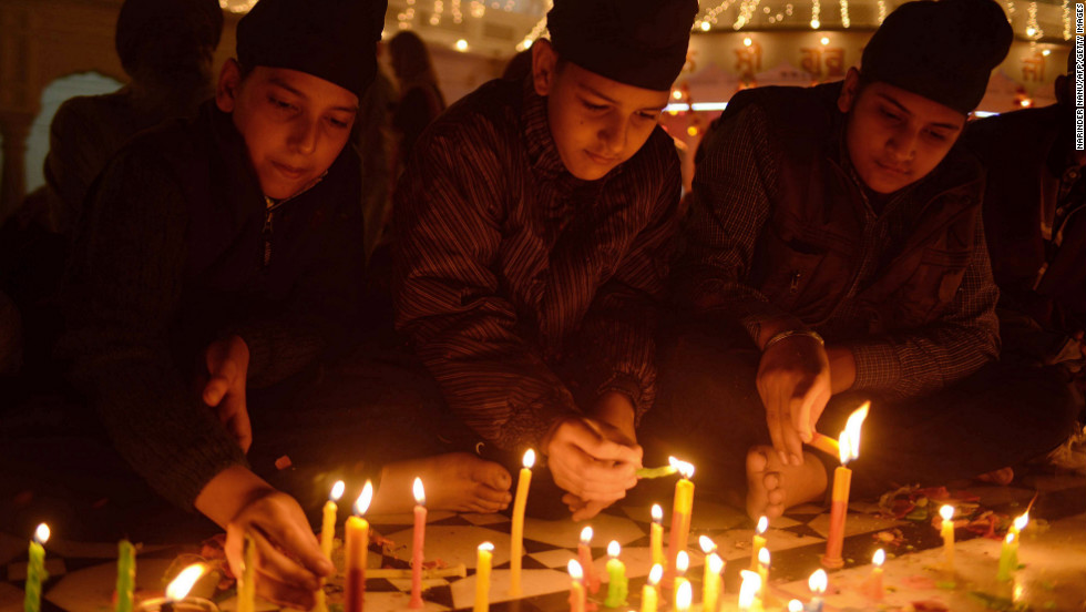Devotees light candles as they pay their respects at the Golden Temple in Amritsar on Wednesday.