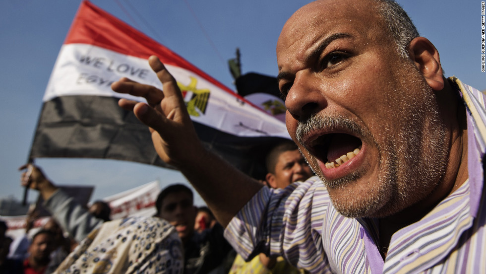 A man shouts as protesters gather in Tahrir Square on November 30.